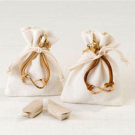 4 Bracelets Infini Ornés en Sachet avec 2 Bonbons