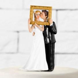 Figurines de mariés avec cadre photo