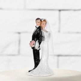 Figurines de mariés avec un bouquet de fleur